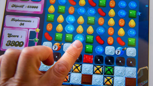 A person plays on his tablet with Candy Crush Saga games developed by British King Digital Entertainment.
