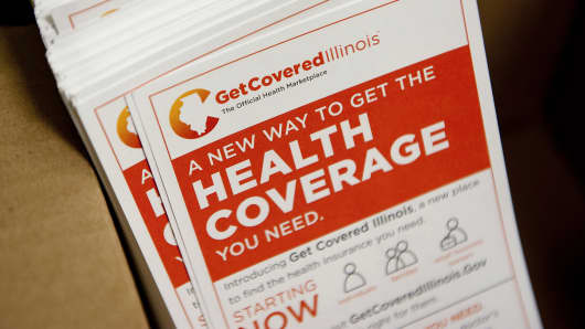 Fliers promoting the Get Covered Illinois health insurance marketplace sit in a box at the Bureau County Health Department offices in Princeton, Ill.