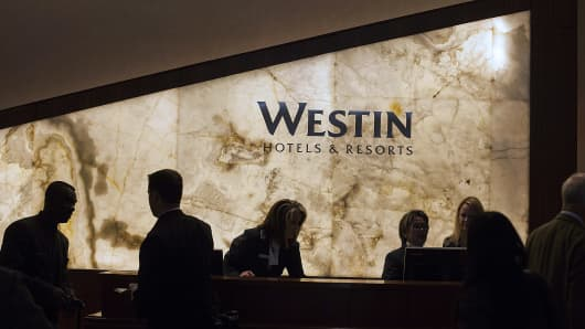 Employees assist guests at the Starwood Hotels & Resorts Worldwide Westin New York Grand Central in New York.