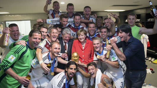 Angela Merkel celebrates with the German national team after their World Cup win