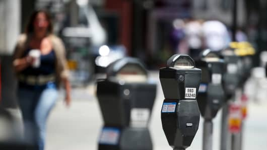 A row of parking meters on O'Farrell Street in San Francisco.