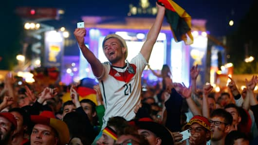 Fans of Germany celebrate as they watch the 2014 World Cup final between Germany and Argentina.