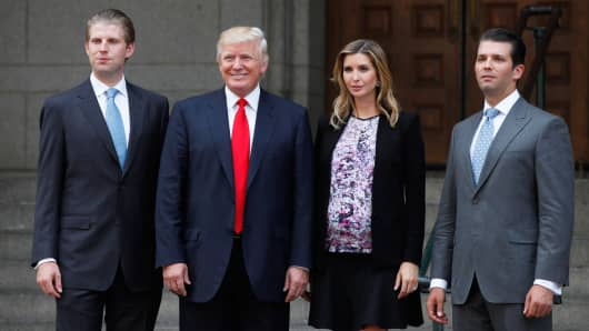 Donald Trump, second from left, stands for a photo with sons Eric Trump, left, Donald Trump Jr., right, and daughter Ivanka Trump, in Washington, Sept. 10, 2013.
