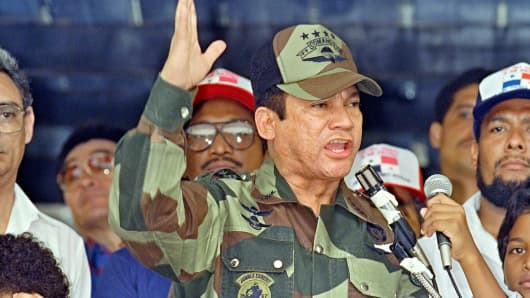 Manuel Noriega speaks in 1988 during the presentation of colors to the San Miguel Arcangel de San Miguelito volunteer battalion in Panama City, Panama.