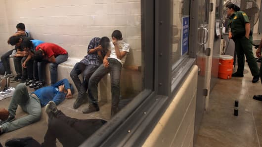 People detained for crossing the border illegally are housed inside the McAllen Border Patrol Station in McAllen, Texas.