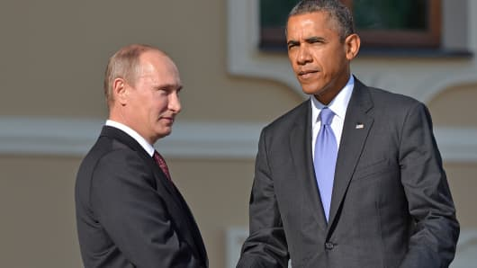 Russian President Vladimir Putin, left, and U.S. President Barack Obama shake hands during the G20 Summit in St. Petersburg, Russia.
