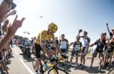 Chris Froome, winner of the 2013 Tour de France, is cheered on by cycling enthusiasts who paid Thomson Bike T