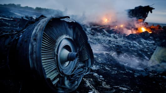 Debris from Malaysia Airlines Flight 17 is shown smoldering in a field on July 17, 2014, in Grabovo, Ukraine, near the Russian border.