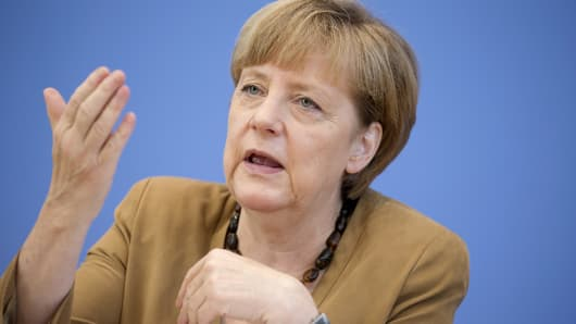 German Chancellor Angela Merkel addresses a news conference in Berlin, July 18, 2014.