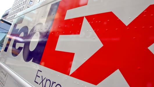 A FedEx logo on a delivery truck