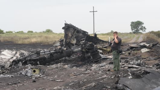 part of plane is seen amongst the wreckages of MH17 after it was downed close to Russia's border with Ukraine near the town of Donetsk.