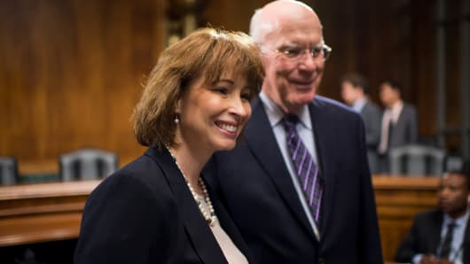 File photo: Patricia Ann Millett, nominee to be U.S. circuit judge for the District of Columbia Circuit, speaks with chairman Patrick Leahy, D-Vt., before the Senate Judiciary Committee hearing on the nominations of four judges on Wednesday, July 10, 2013.