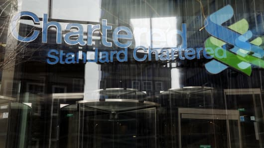 A logo is seen outside the headquarters of Standard Chartered in London, U.K.