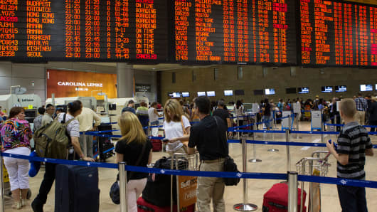 Passengers on line for security control before departure at the Ben Gurion International airport in Tel Aviv July 22, 2014.
