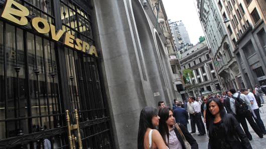 People pass in front of the Brazilian Stock Exchange, Bovespa, in Sao Paulo, Brazil.