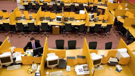 A trader sits at his desk after trading was suspended at the Moscow Interbank Currency Exchange in Moscow, Russia.