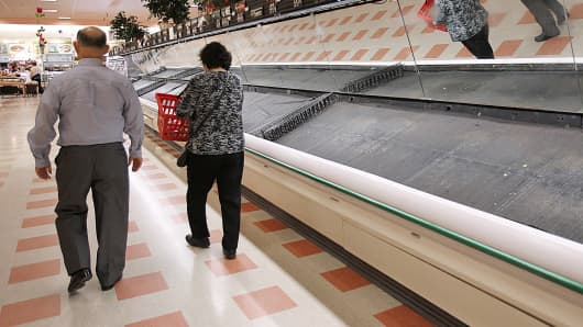 Empty shelves are shown at a Market Basket store in Burlington, Mass.
