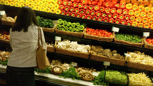 A customer in the produce section of a Whole Foods Market branch in New York City.