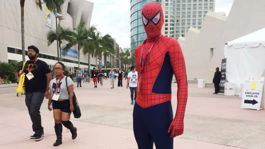An attendee dressed as Spider-Man arrives for Comic Con 2014 in San Diego.
