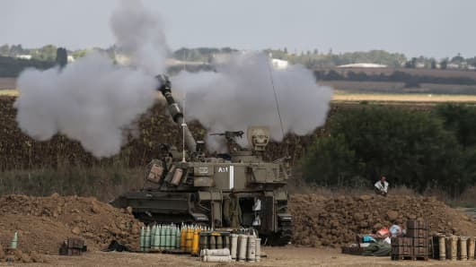 Israeli artillery fire near the Israeli-Gaza border on July 25, 2014 near Israel's border with the Gaza Strip.