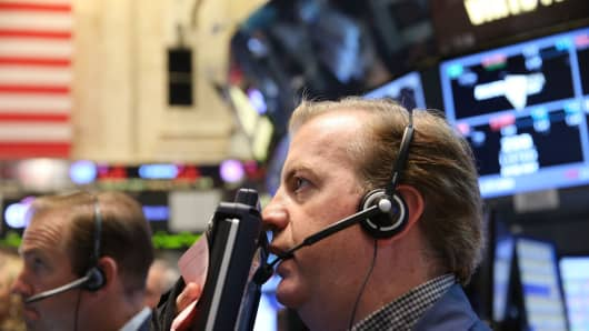Traders work on the floor of the New York Stock Exchange (NYSE) on Friday.