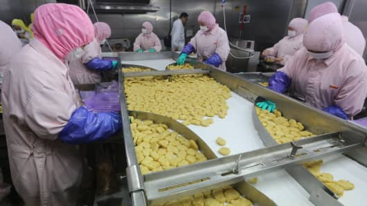 Workers at the Shanghai Husi Food Co