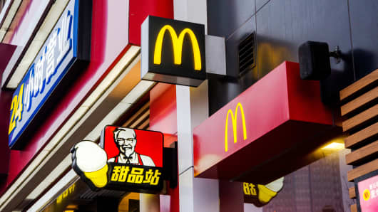 A 24 hour McDonald's restaurant and a KFC store in a shopping mall in China.