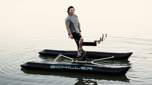 Judah Schiller floats on Schiller Sports' X1 water bike.