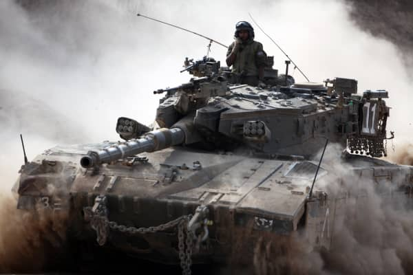 An Israeli army Merkava tank rolls along the border between Israel and the Hamas-controlled Gaza Strip on July 28, 2014.