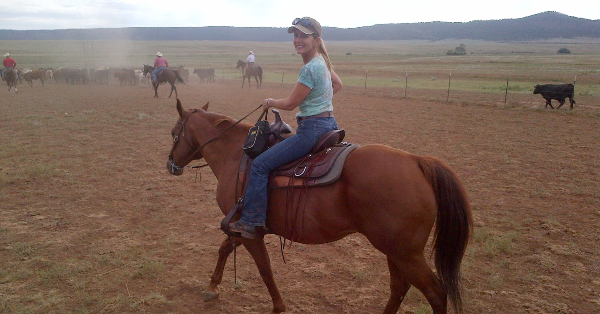Andrea Sloan enjoying time with her beloved horse Heathen.