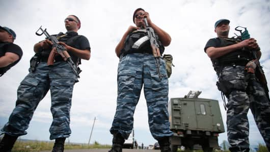 Armed pro-Russian separatists stand guard near the village of Hrabove, Donetsk region, Ukraine.