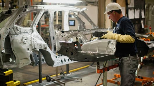 An employee works on the production line at the Subaru of Indiana Automotive assembly plant in Lafayette, Indiana, July 24, 2014.