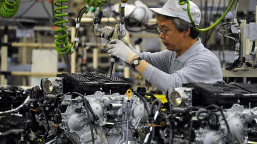 A factory worker assembles Nissan's VQ engine on the line at the Iwaki engine plant in Iwaki, Fukushima prefecture, Japan.