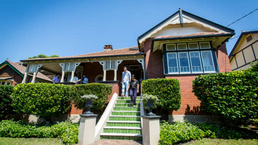 Prospective buyers inspect a house for sale in the suburb of Eastwood in Sydney, Australia.