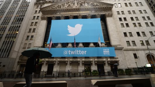 A banner with the logo of Twitter is set on the front of the New York Stock Exchange.