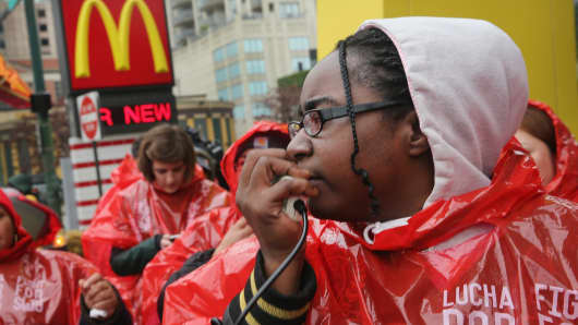 Fast food workers and activists demonstrate outside McDonald's downtown flagship restaurant on May 15, 2014 in Chicago, Illinois.