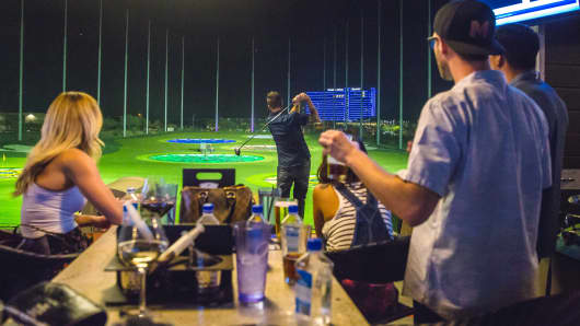 Customers play at the opening of Topgolf's Scottsdale, Ariz., location.