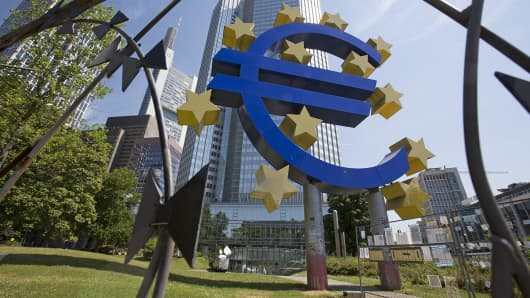A euro sculpture is seen in front of the headquarters of the European Central Bank in Frankfurt, Germany.