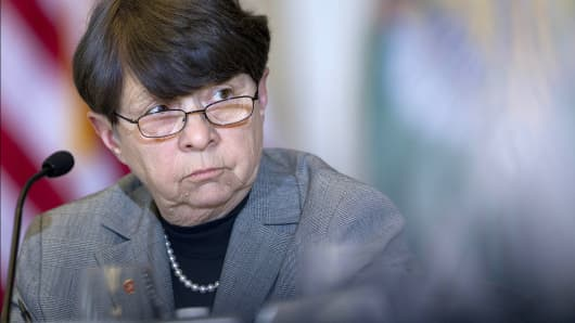 Securities and Exchange Commission Chair Mary Jo White listens during a meeting at the Treasury Department in Washington.