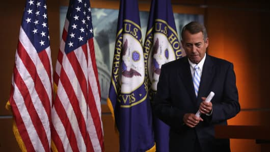 Speaker of the House Rep. John Boehner (R-OH) leaves after a press briefing July 31, 2014 on Capitol Hill in Washington, DC. Boehner held his weekly news briefing to discuss Republican agenda.