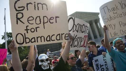 File photo of opponents of the Affordable Care Act rally before the Supreme announces its decision about the constitutionality of the President's efforts on hea
