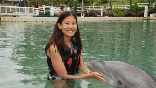 Nathalie Traller swims with a dolphin during a trip to Hawaii, sponsored by the Make-A-Wish Foundation, in August 2012.