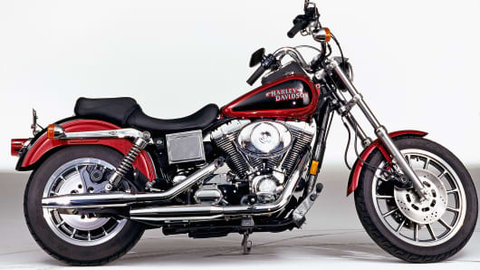 The side profile of a red Harley-Davidson FXDL Dyna Low Rider motorcycle.