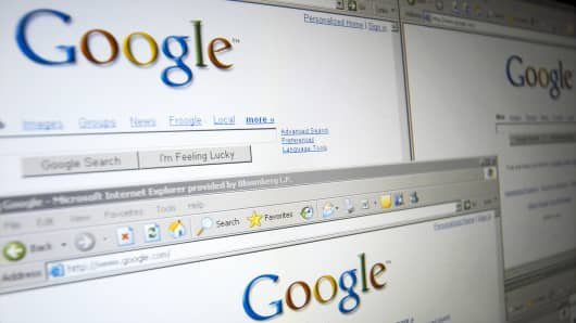 A screen shot of the Google logo on several windows of its homepage is shown.
