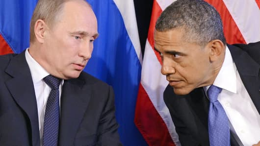 President Barack Obama listens to Russian President Vladimir Putin during a meeting in 2012.