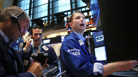 Traders work on the floor of the New York Stock Exchange, Aug. 1, 2014, in New York.