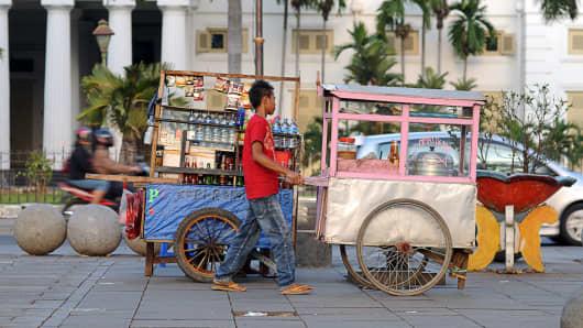 Hawkers before fine arts museum, taman fatahillah, jakarta, indonesia