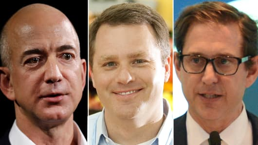 Jeff Bezos, CEO of Amazon Inc.(L), Doug McMillon, president and CEO of Wal-Mart Stores, Inc.(C) and Richard Baker, Governor and CEO of HBC (R).