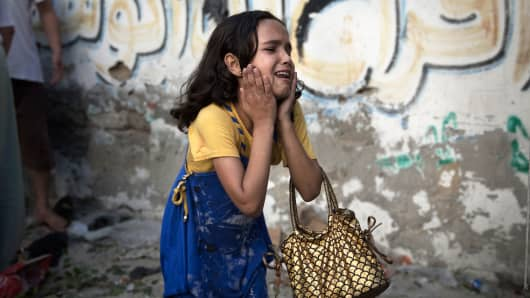 A Palestinian girl reacts at the scene of an explosion, July 28, 2014.