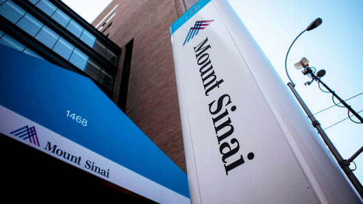Signage hangs outside Mount Sinai Hospital on August 4, 2014 in New York City.